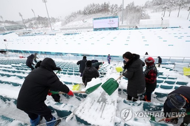 5 2018 workers for the Pyeong Chang Winter Paralympic Games clear snow at Alpensia Biathlon Centre in PyeongChang Gangwon Province