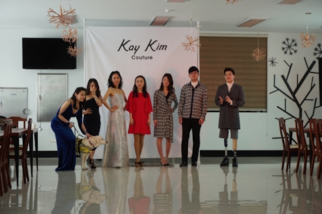 The fashion show participants including the guide dog (Image: Yonhap)
