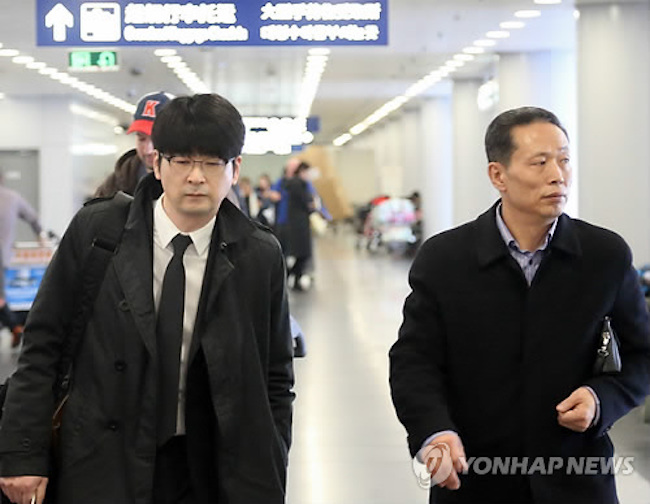 The team of government officials and experts boarded a North Korean flight in Beijing on Thursday for a three-day visit as the South's 160-member art troupe will hold two concerts in Pyongyang between March 31 and April 3, they said. (Image: Yonhap)