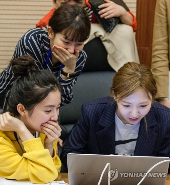 Members of Red Velvet checking out North Korea's internet. (Image: Yonhap)
