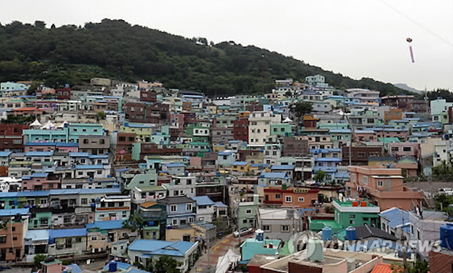 Besides its enviable skyline unrivaled by domestic peers, the city is also home to seven nuclear reactors currently in operation, as well as 206 neighborhoods served only by narrow alleys. (Image: Yonhap)