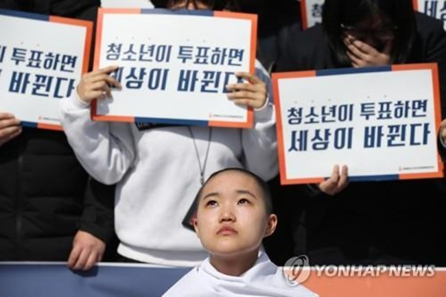 "Teenage protestor Kim Yoon-song, who shaved her head as a show of defiance, said, ""Having no voting rights is to be excluded from the make-up of society in school, at home and in the workplace. Depriving teenagers of the right to vote is abuse of power and a form of aggression against teenagers."" (Image: Yonhap)"