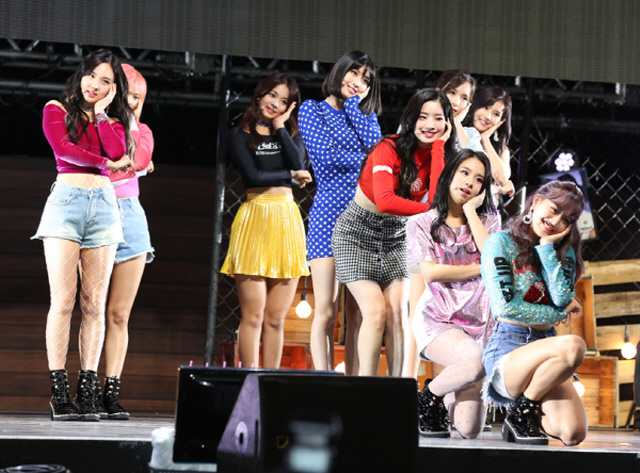 "K-pop girl group TWICE performing on stage during a media showcase for its new EP album ""What is Love?"" at Yes 24 Live Hall in eastern Seoul on April 9, 2018. (image: JYP Entertainment)"