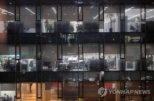 A view of office workers inside a building. (image: Yonhap)