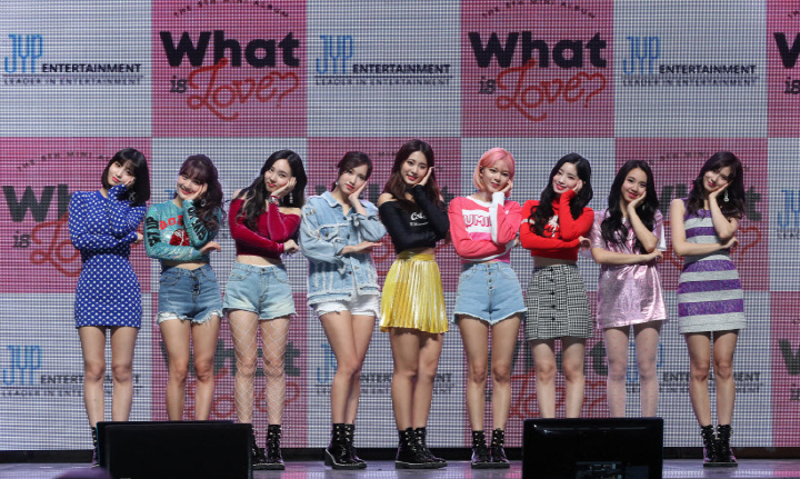 "South Korean girl group Twice poses for a photo during a showcase for the group's fifth EP, ""What Is Love?"" in Seoul on April 9, 2018. (image: JYP Entertainment)"