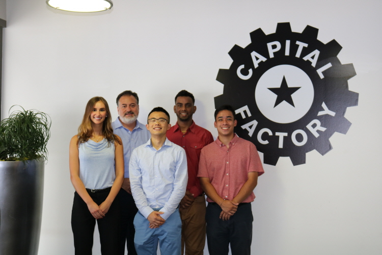 DigitalTown Global Youth Ambassadors Matthew Cheng, Abigail Eymontt, Sahib Gill, and Jerry Liu working at Capital Factory in Austin, Texas with Frank Robles, Vice President of Operations. (image: DigitalTown, Inc.)