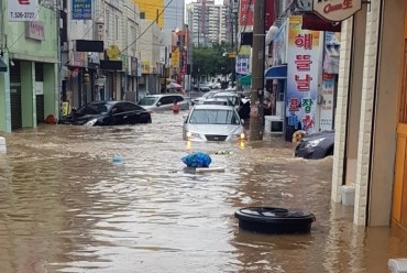 Heavy Downpours Batter S. Korea
