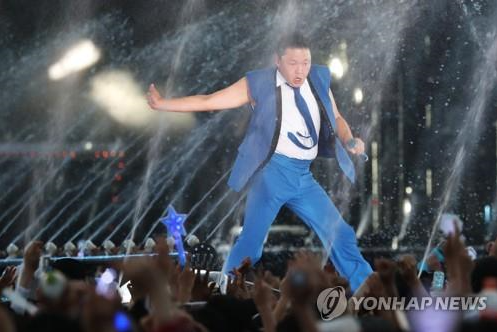 Psy Beats Sweltering Summer Heat with Water-Shower Show