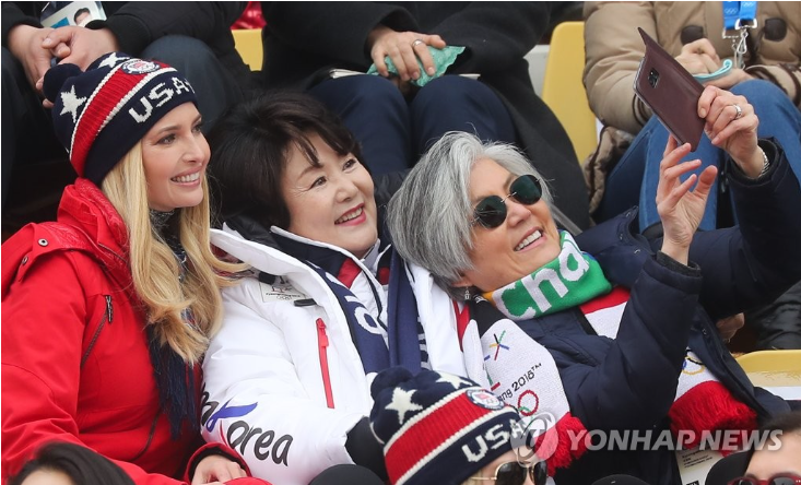 This photo shows Ivanka Trump (L) taking a selfie with South Korea's first lady Kim Jung-sook (C) and South Korean Foreign Minister Kang Kyung-wha during an event at the PyeongChang Winter Olympics on Feb. 24, 2018. (Yonhap)