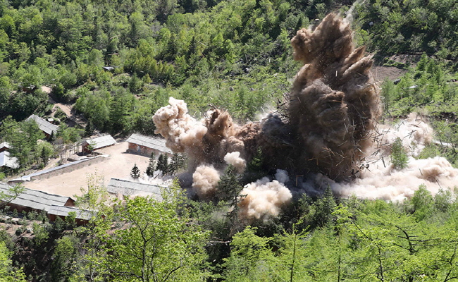 This photo, provided by North Korea's state news agency on May 25, 2018, shows North Korea's demolition of its Punggye-ri nuclear test site on the northeast. (Yonhap)
