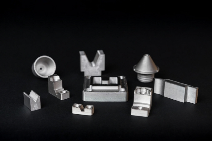 A selection of parts printed in H13 including wear-resistant inserts for fixtures, punch tooling, press brake fingers and a selection of nozzles. (image: Markforged)