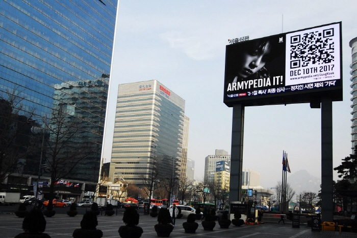 "A billboard showing a teaser image for ""Armypedia"" put up in central Seoul. (image: Big Hit Entertainment)"