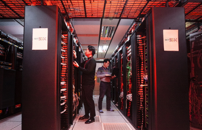 Officials at SK Telecom Co. check a network server in Seoul. (image: SK Telecom)