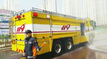 Fire Trucks Water City Streets to Prevent Dust