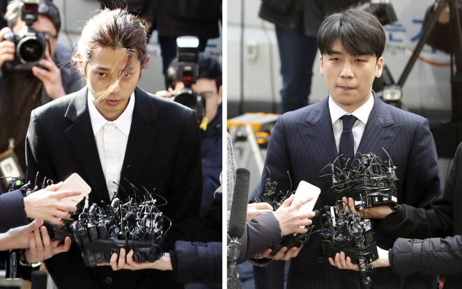 Singer Jung Joon-young (L) and Seungri of BIGBANG appear for police interrogations on March 14, 2019 at the Seoul Metropolitan Police Agency over a widening sex and corruption scandal. (Yonhap)