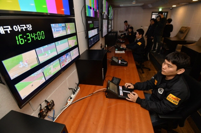 Introduced to make fair and accurate decisions, video reviewing has sometimes been a decisive factor in deciding the outcome of a game, and a medium of interest for fans. (Yonhap)