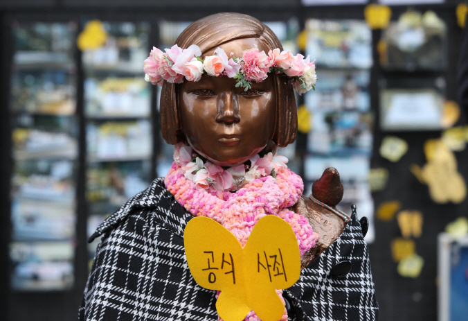 A statue symbolizing South Korean sex slave victims erected in front of the former site of the Japanese Embassy in Seoul. (Yonhap)