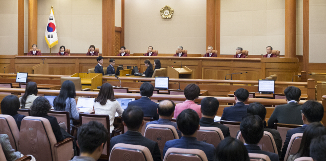 The nine Constitutional Court justices sit in the courtroom ahead of a ruling on anti-abortion law on April 11, 2019. (Yonhap)