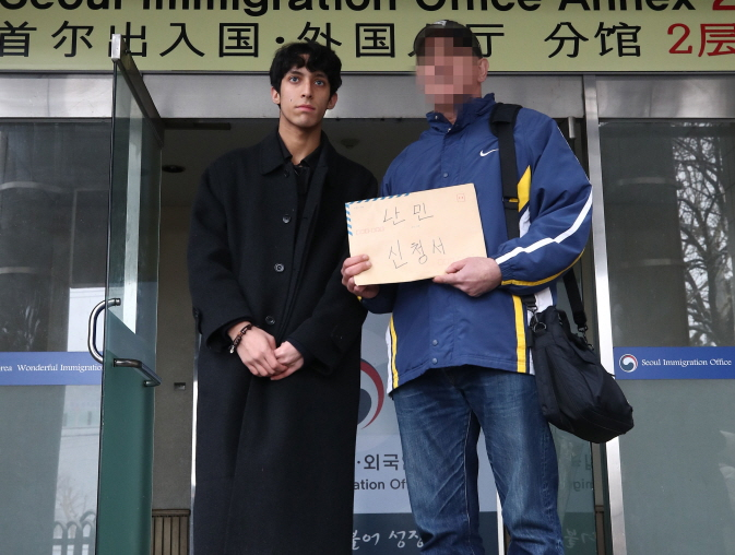 Iranian man, A (R) and his son Kim Min-hyuk,(L) who was granted status as a refugee. (Yonhap)
