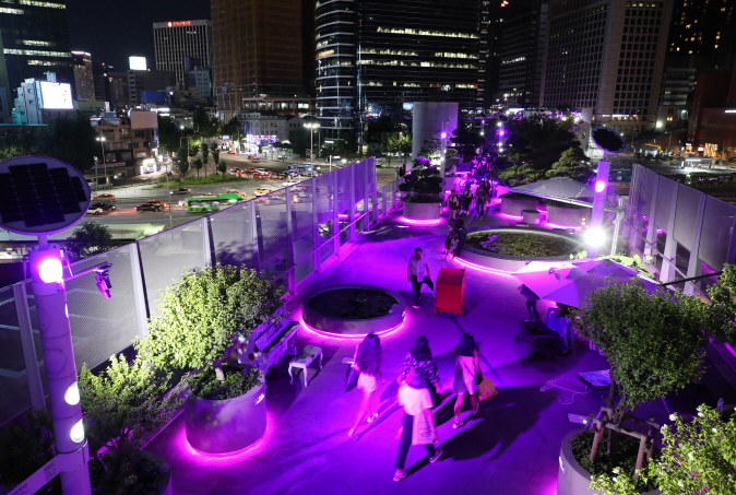 Landmarks in Seoul Illuminated in Violet to Celebrate BTS' Fan Meeting