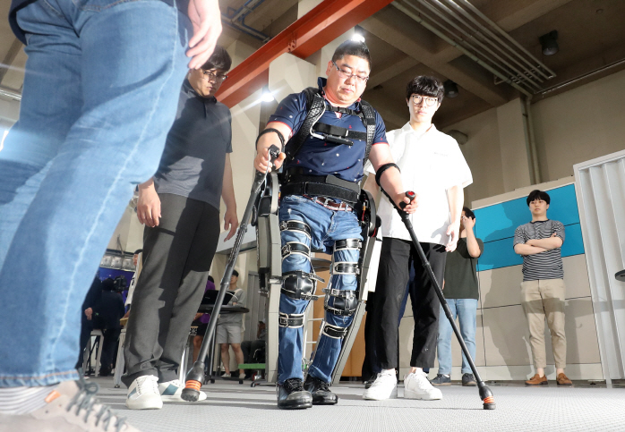 Wearable Robots to Help Persons with Disabilities
