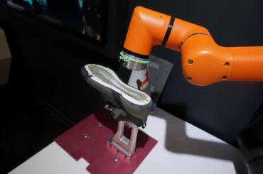 Cooperation Robot Helps Produce Handmade Shoes