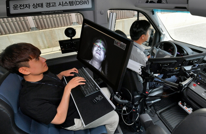 Hyundai Mobis' engineers test the driver state warning (DSW) system in a commercial vehicle. (image: Hyundai Mobis)