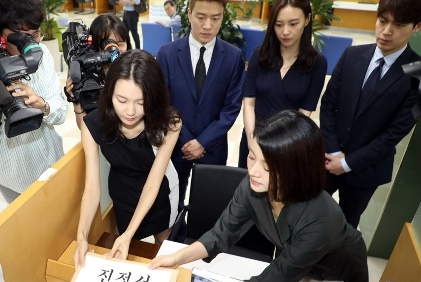 A group of nonregular announcers with broadcaster MBC files a petition against workplace bullying with a state labor office in Seoul on July 16, 2019, as a new law aimed at preventing harassment in the workplace takes effect in South Korea. (Yonhap)