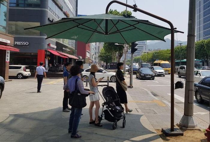 Pedestrian Crossing Parasols Spreading Across S. Korea