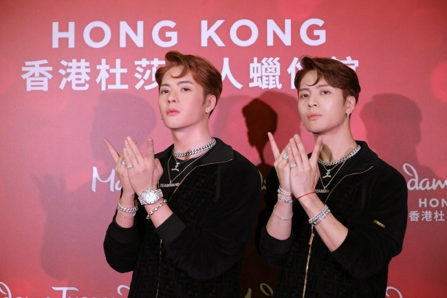 GOT7 member Jackson (R) and his wax replica. (image: Team Wang)