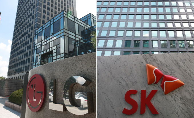 The headquarter buildings of LG Chem Inc. (R) and SK Innovation Co. in Seoul. (Yonhap)