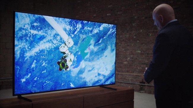 Samsung Electronics Co.'s QLED TV shows a sky view of Earth. (image: Samsung Electronics)