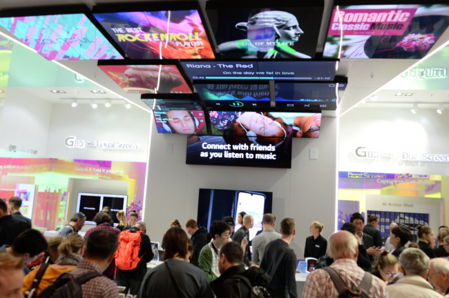 Visitors crowd LG Electronics Inc.'s exhibition booth for its new flagship smartphone with dual display, the V50S, at the IFA technology show in Berlin, Germany, on Sept. 8, 2019. (image: LG Electronics)