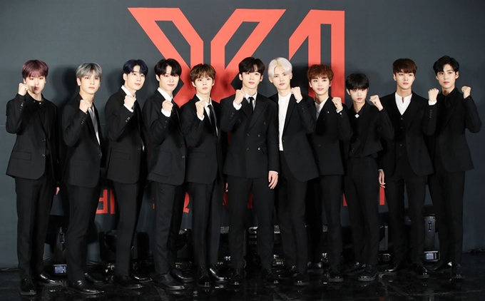 X1 members posing for photos ahead of the group's official debut on Aug. 27, 2019. (Yonhap)