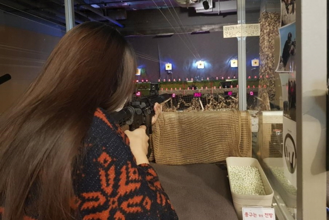 Young Korean Women Turn to BB Guns to Shoot Away Stress