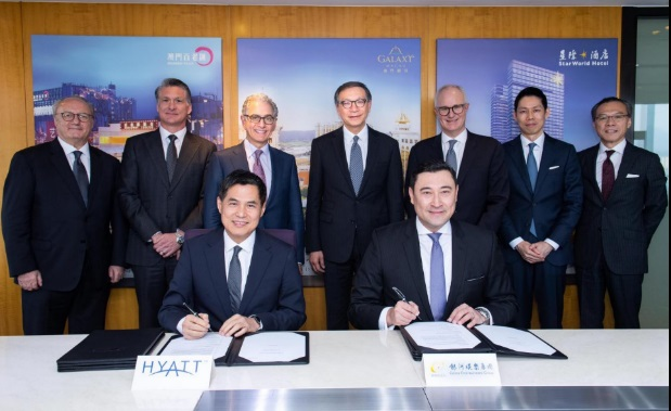 (Back row, left to right) Mr. Andreas Stalder, Senior Vice President, Food & Beverage Operations and Product Development, Asia Pacific of Hyatt Hotels & Resorts; Mr. Scott Kreeger, Director, Operations Development, New Resort of Galaxy Entertainment Group; Mr. Mark S. Hoplamazian, President and Chief Executive Officer of Hyatt Hotels Corporation; Mr. Francis Lui, Vice Chairman of Galaxy Entertainment Group; Mr. David Udell, Group President, Asia Pacific of Hyatt Hotels Corporation; Mr. Brian Lum, Vice President, Design Services, Asia Pacific of Hyatt Hotels & Resorts; and Mr. Raymond Kwok, Senior Director, Legal of Galaxy Entertainment Group witnessed the signing of the contract by (front row, left to right) Mr. Stephen Ho, President, Greater China, Global Operations of Hyatt Hotels & Resorts and Mr. Troy Hickox, Head of Hotels & Lifestyle Development of Galaxy Entertainment Group.