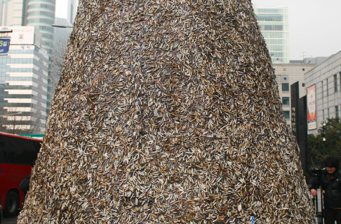 Christmas Tree Made of Cigarette Butts Spreads Awareness of Environmental Pollution