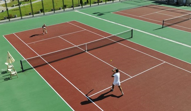 7776689 - happy young couple play tennis game outdoor man and woman