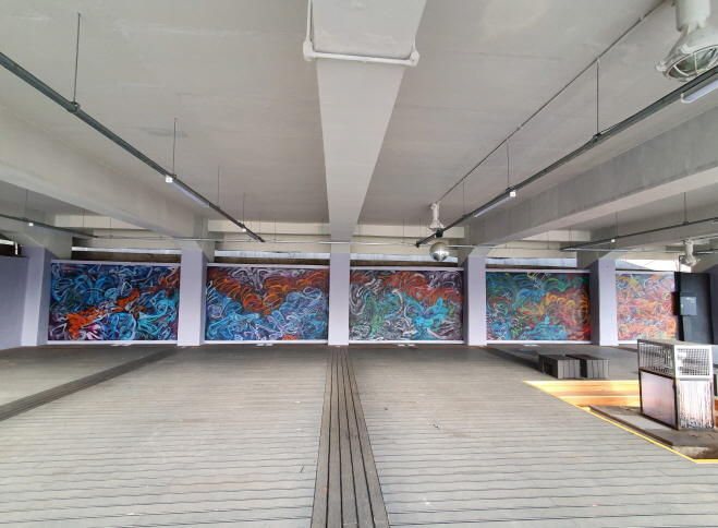 Artists Paint Mural at Oil Tank Culture Park in Seoul