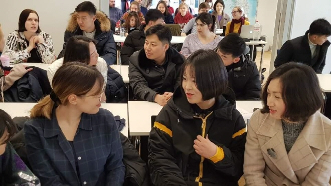 North Korean students talk with German students in a class of the Free University of Berlin in the German capital on Jan. 5, 2020. (Yonhap)