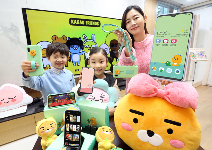 This photo provided by LG Uplus Corp. on Jan. 16, 2020, shows models promoting the company's Kakao Little Friends Phone 3 designed for children at an event in Seoul.