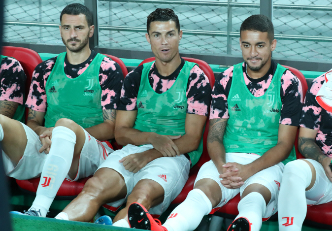 This photo from July 26, 2019, shows Cristiano Ronaldo (C) sitting on the bench during the exhibition match held between a K League All-Star team and Juventus FC at the Seoul World Cup Stadium. (Yonhap)