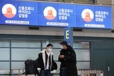 Passengers from China Undergo Strict Quarantine Screening Under Entry Ban