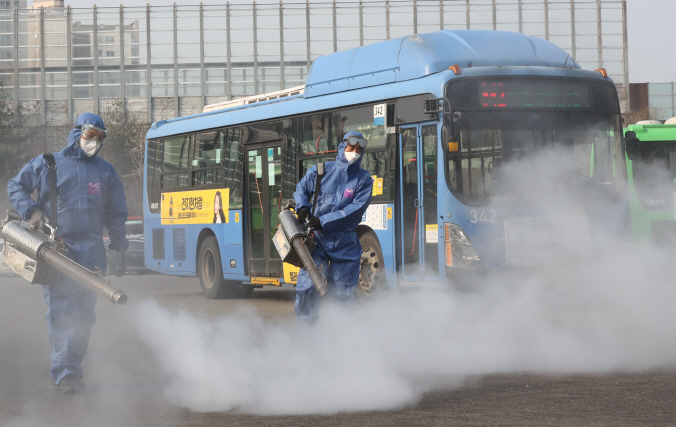 Health officials disinfect a public bus terminal in eastern Seoul on Feb. 20, 2020. (Yonhap)