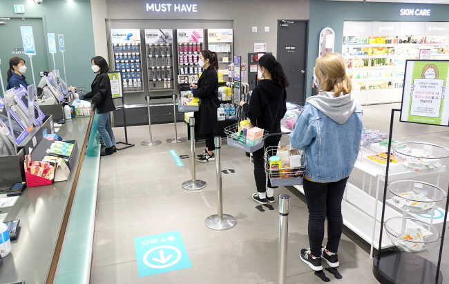 Footprint Stickers Encourage Social Distancing at Checkout Counters