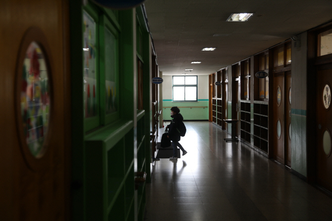A file photo of a student using a child care program. (Yonhap)