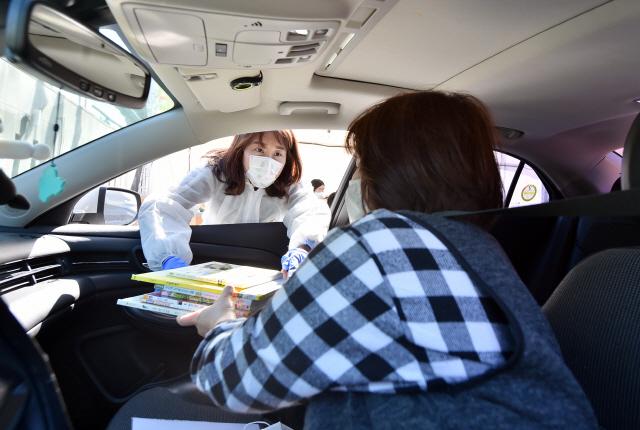 World Follows Suit with Korean-style Drive-through Coronavirus Test Centers