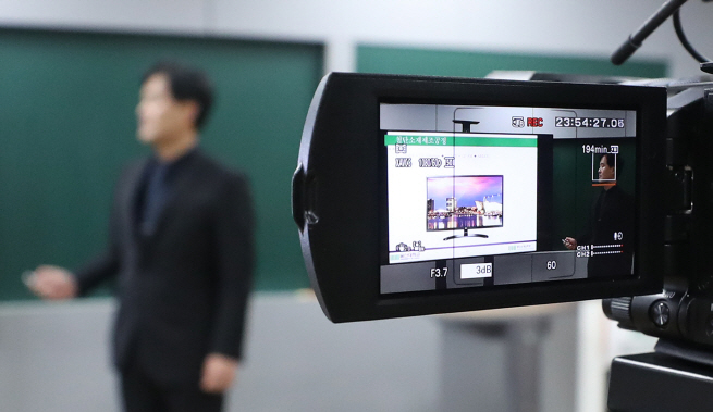 A university professor records his lectures in one of the school's lecture rooms on March 12, 2020.