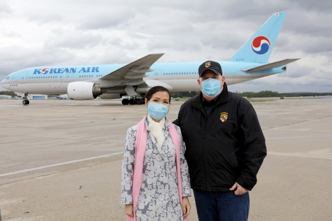 This photo, posted on Maryland Gov. Larry Hogan's Twitter, shows the governor (R) and his wife, Yumi, welcoming a shipment of South Korean coronavirus test kits at BWI airport in Baltimore, Maryland, on April 18, 2020.