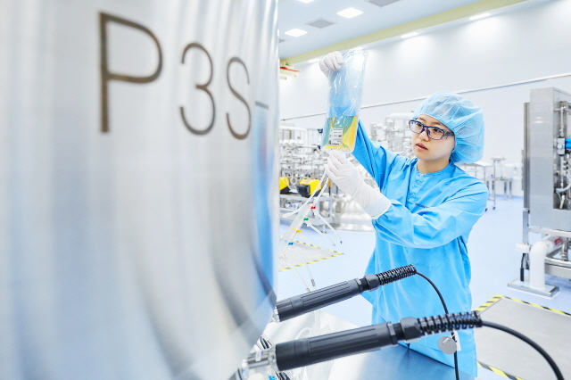 This undated photo provided by Samsung BioLogics, a biopharmaceutical unit of Samsung Group, shows a researcher working.